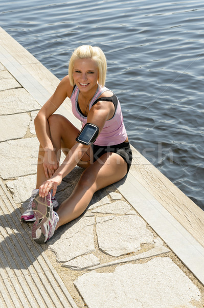 Young sport woman stretch legs marina pier Stock photo © CandyboxPhoto