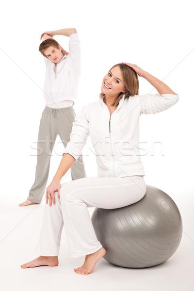Stock fotó: Fitnessz · egészséges · pár · nyújtás · képzés · fehér