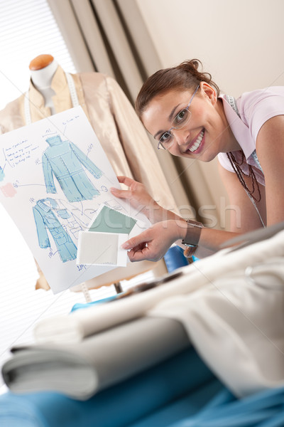 Female fashion designer working at studio with pattern cuttings Stock photo © CandyboxPhoto