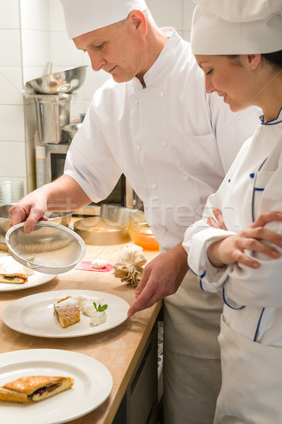 Male baker showing apprentice serving puff pastry Stock photo © CandyboxPhoto