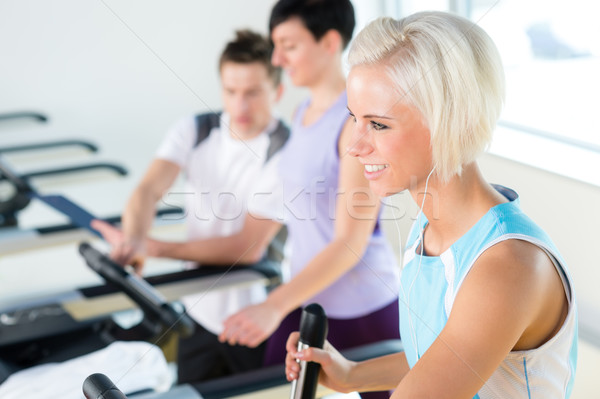 Fitness young people on treadmill cardio workout Stock photo © CandyboxPhoto