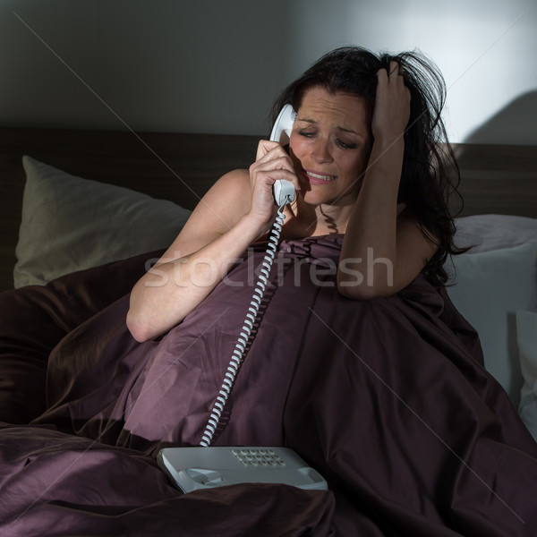 Crying woman calling phone in bed Stock photo © CandyboxPhoto