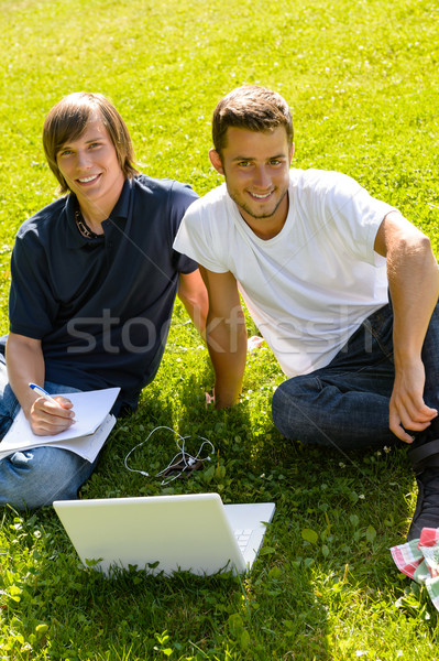 Teens sitting in park with laptop students Stock photo © CandyboxPhoto