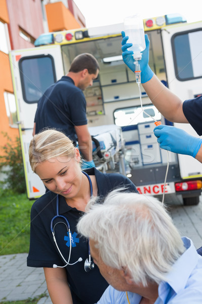 Paramedical team helping injured patient on street Stock photo © CandyboxPhoto