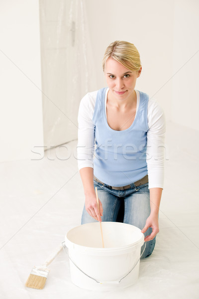 Home improvement - handywoman painting wall Stock photo © CandyboxPhoto