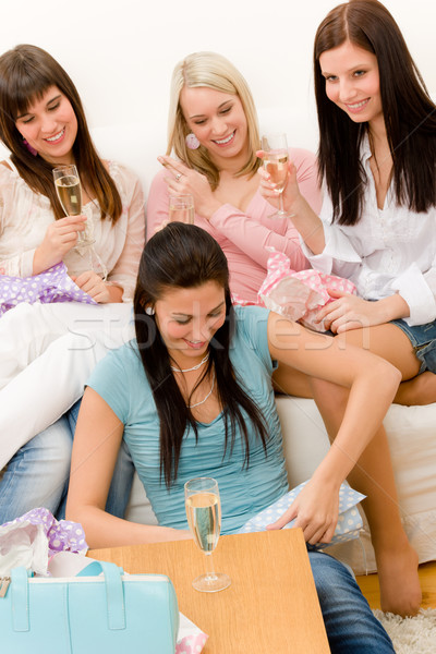 Birthday party - woman unwrap present, celebrate Stock photo © CandyboxPhoto