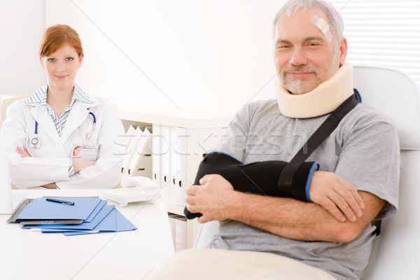 Senior patient broken arm in doctor office Stock photo © CandyboxPhoto