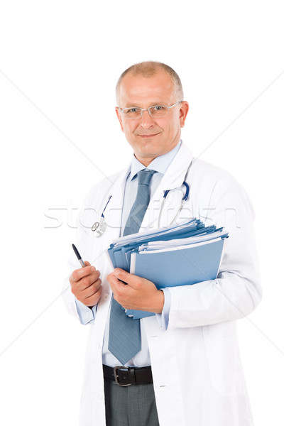 Stock photo: Mature doctor male with stethoscope professional