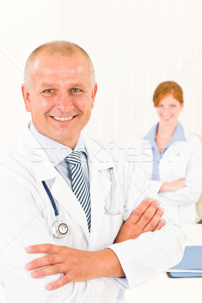 Medical team senior smiling male young woman Stock photo © CandyboxPhoto