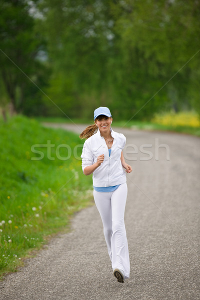 Jogging - sportive woman running on road in nature Stock photo © CandyboxPhoto