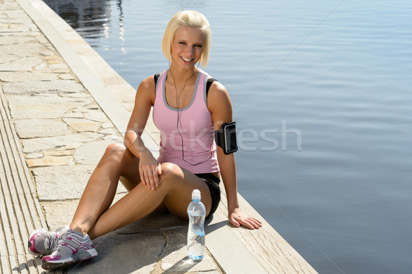 Sport woman smiling relax water sitting pier Stock photo © CandyboxPhoto