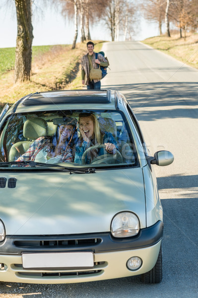 Exciting girls drive car taking hitch-hiker Stock photo © CandyboxPhoto