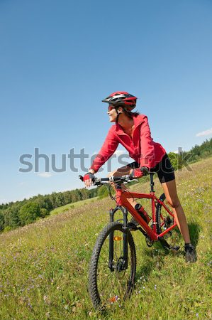 Young woman with mountain bike in spring nature Stock photo © CandyboxPhoto