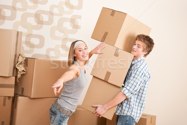 Moving house: Man and woman with box Stock photo © CandyboxPhoto