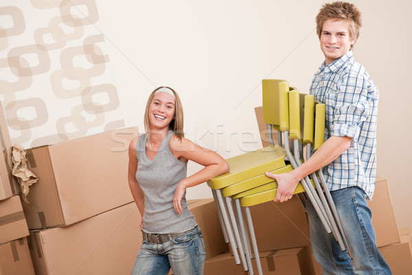 Moving house: Young couple with box and chair Stock photo © CandyboxPhoto