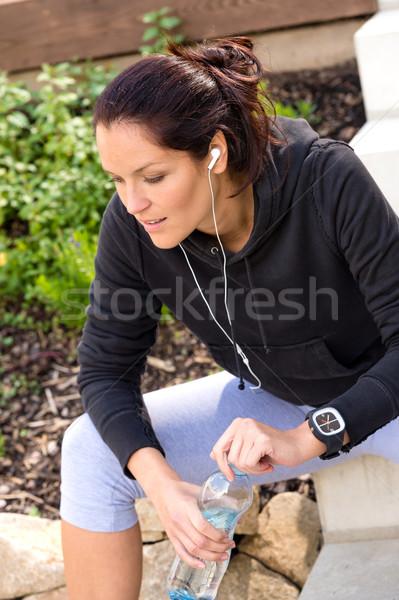 Tired woman relaxing running bottle headphones sweatsuit Stock photo © CandyboxPhoto