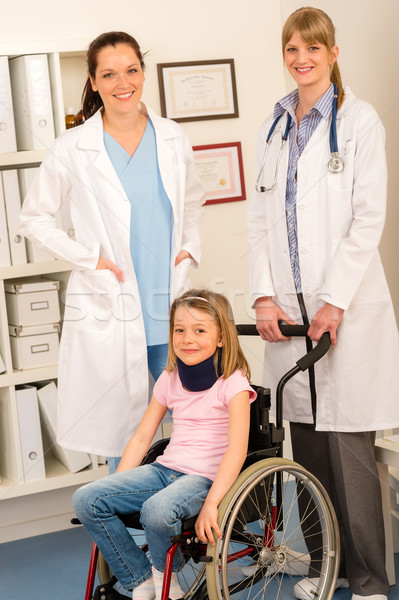Girl on wheelchair get doctor assistance Stock photo © CandyboxPhoto