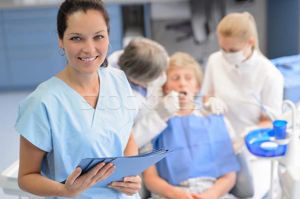 プロ 歯科 チーム 十代の 患者 少年 ストックフォト © CandyboxPhoto