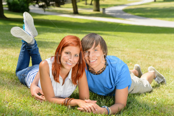 Smiling couple lying in park first love Stock photo © CandyboxPhoto