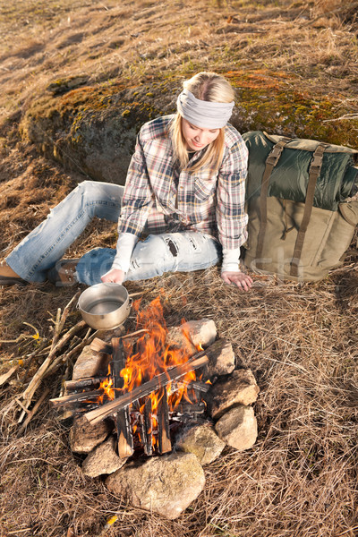 Hiking woman with backpack cook by campfire Stock photo © CandyboxPhoto