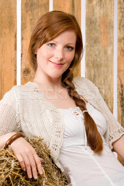 Romantic young woman sitting on hay barn Stock photo © CandyboxPhoto