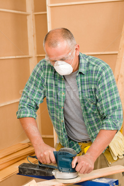 Handyman sanding wooden board diy home renovation Stock photo © CandyboxPhoto