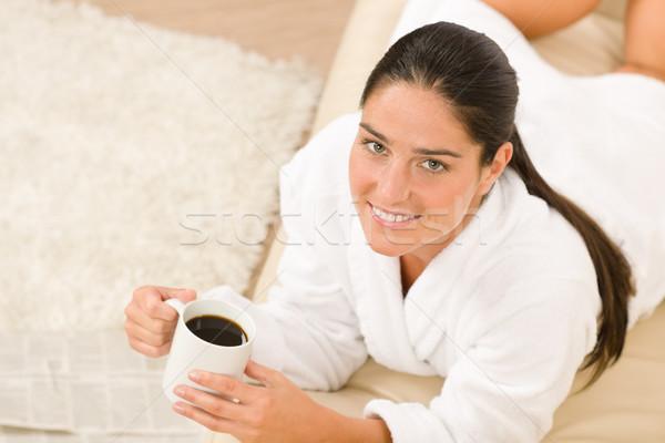 белый халат диван кофе газет Сток-фото © CandyboxPhoto