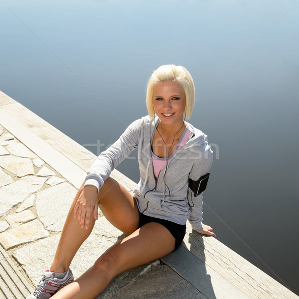 Stock photo: Sport woman relax on pier sitting water
