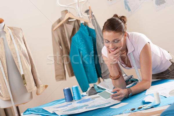 Vrouwelijke mode ontwerper werken studio patroon Stockfoto © CandyboxPhoto