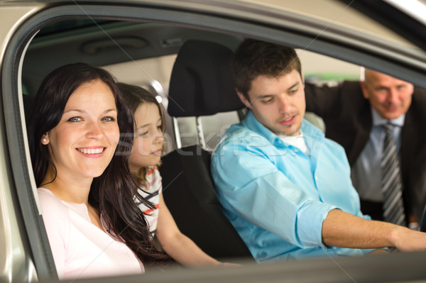 Family sitting in car in retail store Stock photo © CandyboxPhoto