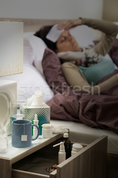 Flu medicines on bedside table ill woman Stock photo © CandyboxPhoto