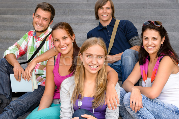 Students sitting on school stairs smiling teens Stock photo © CandyboxPhoto
