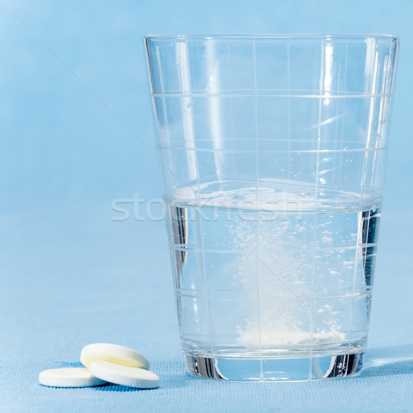Fizzy vitamin capsule throw in water glass Stock photo © CandyboxPhoto