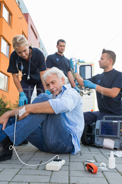 Paramedical team giving firstaid to injured man Stock photo © CandyboxPhoto