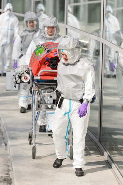 Biohazard medical team with stretcher outside building Stock photo © CandyboxPhoto