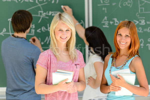 Two smiling student girls in math class Stock photo © CandyboxPhoto