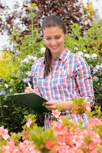 Smiling woman doing inventory at garden center Stock photo © CandyboxPhoto