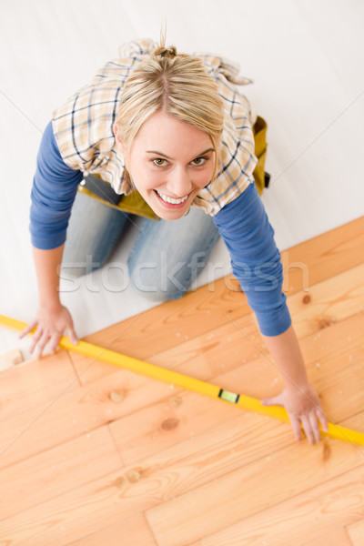 Home improvement - handywoman installing wooden floor Stock photo © CandyboxPhoto
