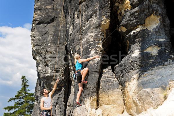 Kaya tırmanışı erkek eğitmen sarışın kadın güneşli Stok fotoğraf © CandyboxPhoto