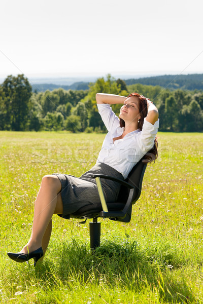 Young businesswoman sunny meadow relax on armchair Stock photo © CandyboxPhoto