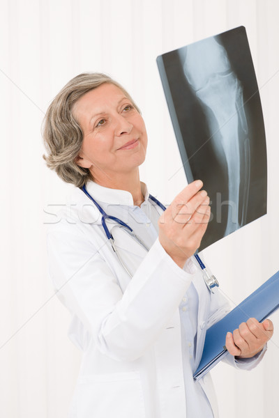 Senior doctor female happy hold x-ray Stock photo © CandyboxPhoto