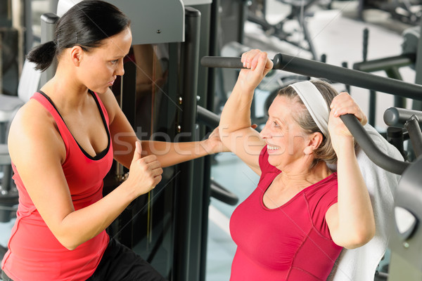 Personal trainer assist senior woman at gym Stock photo © CandyboxPhoto