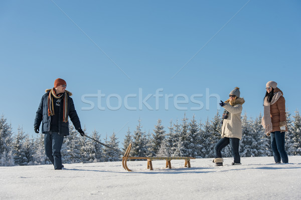 Young man pulling snow sledge winter countryside Stock photo © CandyboxPhoto