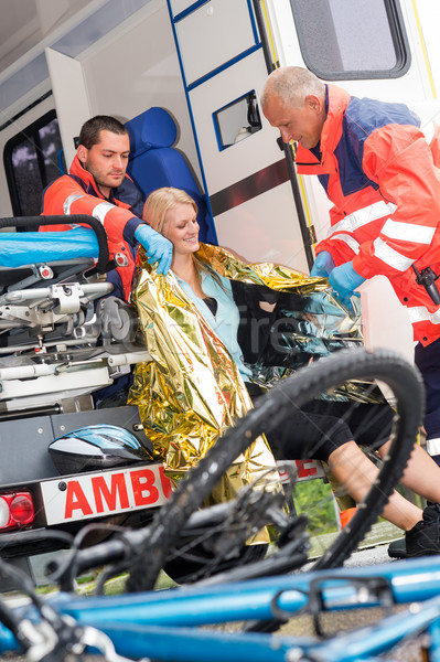 Emergency paramedics helping woman bike accident Stock photo © CandyboxPhoto