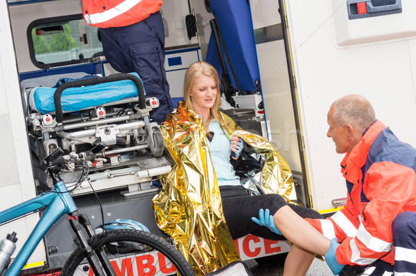 Paramedics with woman bike accident in ambulance Stock photo © CandyboxPhoto
