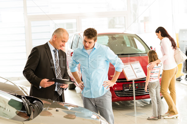Car agent showing vehicle to young family Stock photo © CandyboxPhoto