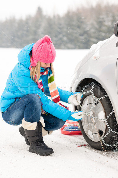 Woman putting winter tire chains car wheel Stock photo © CandyboxPhoto