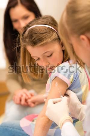Pediatrician examine child tummy at office Stock photo © CandyboxPhoto