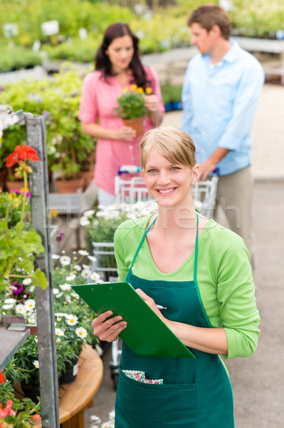 Smiling florist woman at garden centre inventory Stock photo © CandyboxPhoto