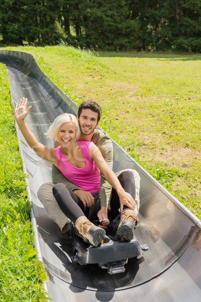 Boldog pár élvezi nyár szánkó portré Stock fotó © CandyboxPhoto